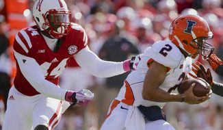 FILE - In this Oct. 5, 2013, file photo, Nebraska defensive end Randy Gregory (44) pursues and later sacks Illinois quarterback Nathan Scheelhaase (2) in an NCAA college football game in Lincoln, Neb. Following practice on Wednesday, March 12, 2014, Neb. coach Bo Pelini said that Gregory hasn't even scratched the surface of what he's going to become, what he's going to be. (AP Photo/Nati Harnik, File)