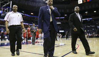 Rutgers head coach Eddie Jordan, center, walks off the court following his team's 92-31 loss to Louisville in an NCAA college basketball game in the quarterfinals of the American Athletic Conference tournament Thursday, March 13, 2014, in Memphis, Tenn. (AP Photo/Mark Humphrey)