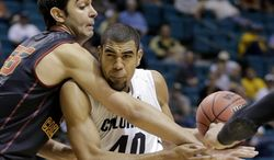 Colorado's Josh Scott, right, is fouled by Southern California's Omar Oraby as he drives to the basket in the first half of an NCAA college basketball game in the Pac-12 men's tournament, Wednesday, March 12, 2014, in Las Vegas. (AP Photo/Julie Jacobson)