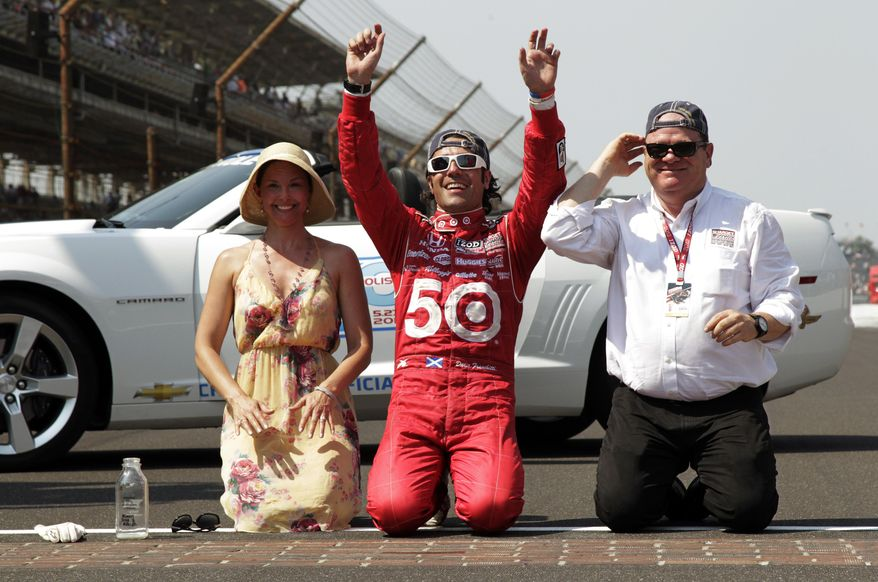 FILE - In this May 27, 2012 file photo, Dario Franchitti, of Scotland, kneels on the track with wife, actress Ashley Judd, and car owner Chip Ganassi after winning IndyCar's Indianapolis 500 auto race at Indianapolis Motor Speedway in Indianapolis. Sponsors come and go in motor sports, where even the strongest partnerships can quickly unravel because of the economy, a difference of opinion or a change in marketing strategy. But Chip Ganassi has developed a partnership with Target that has lasted 25 years in counting, and the team owner considers the relationship with the retail giant a key element in the growth of his race team and Ganassi himself.  (AP Photo/AJ Mast, File)
