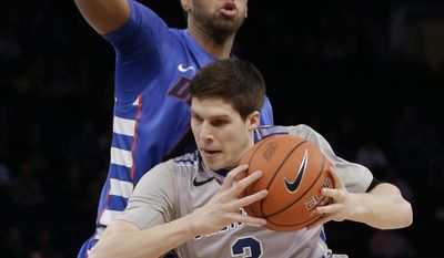 Creighton's Doug McDermott (3) drives past DePaul's Forrest Robinson during the first half of an NCAA college basketball game in the quarterfinals of the Big East Conference tournament on Thursday, March 13, 2014, at Madison Square Garden in New York. (AP Photo/Frank Franklin II)