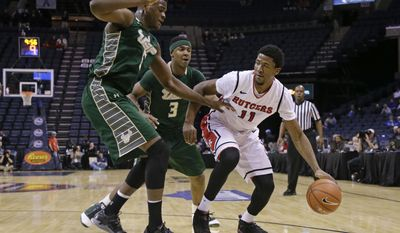 Rutgers forward Kadeem Jack (11) is defended by South Florida's John Egbunu (5) and Zach LeDay (3) during the first half of an NCAA college basketball game at the American Athletic Conference men's tournament Wednesday, March 12, 2014, in Memphis, Tenn. (AP Photo/Mark Humphrey)