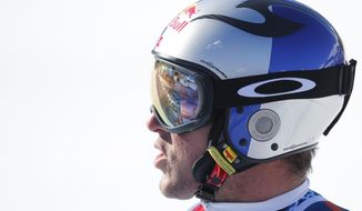 Norway's Aksel Lund Svindal at finish line after a men's alpine skiing Super-G at the World Cup finals in Lenzerheide, Switzerland, Thursday, March 13, 2013. (AP Photo/Marco Trovati)