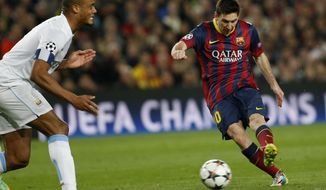 Barcelona's Lionel Messi, right shoots on goal during a Champions League, round of 16, second leg, soccer match between FC Barcelona and Manchester City at the Camp Nou Stadium in Barcelona, Spain, Wednesday March 12, 2014. (AP Photo/Emilio Morenatti)