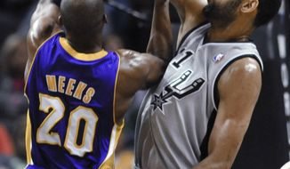 San Antonio Spurs forward Tim Duncan blocks a shot attempt by Los Angeles Lakers guard Jodie Meeks during the first half of an NBA basketball game Friday, March 14, 2014, in San Antonio. (AP Photo/Bahram Mark Sobhani)