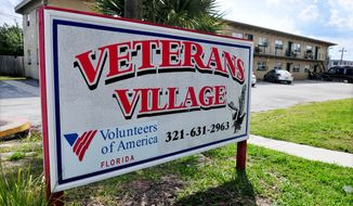 This March 4, 2014 photo shows a sign for Volunteers of America at Veterans Village in Cocoa, Fla. Volunteers of America multi-service center that offers programs to residents and others at Veterans Village, a transitional home for veterans. Residents can stay at the transitional home until they are ready to regain their independence or for up to two years.   (AP Photo/Florida Today, Craig Rubadoux)  NO SALES
