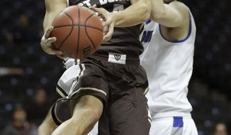 St. Bonaventure's Matthew Wright, left, passes in front of Saint Louis' Rob Loe during the first half of an NCAA college basketball game in the quarterfinal round of the A10 Conference tournament at the Barclays Center in New York, Friday, March 14, 2014. (AP Photo/Seth Wenig)