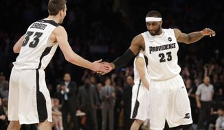 Providence's LaDontae Henton, right, and Carson Desrosiers celebrate during the second half of an NCAA college basketball game against St. John's in the quarterfinals of the Big East Conference tournament at Madison Square Garden, Thursday, March 13, 2014 in New York. Providence defeated St. John's 79-74.(AP Photo/Seth Wenig)