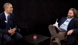 """This image from video released by Funny Or Die shows President Obama, left, with actor-comedian Zach Galifianakis during an appearance on """"Between Two Ferns,"""" the digital short with a laser focus on reaching people aged 18 to 34. Obama's appearance posted Tuesday, March 11, 2014, on the comic website Funny or Die, is at 15 million views by Friday. (AP Photo/Funny Or Die)"""