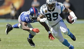 FILE - In this Sept. 22, 2013, file photo, Carolina Panthers' Steve Smith (89) runs after a catch against New York Giants' Prince Amukamara (20) during the first half of an NFL football game in Charlotte, N.C. Smith, a free agent, signed a three-year deal with the Baltimore Ravens on Friday, March 14, 2014. (AP Photo/Bob Leverone, File)