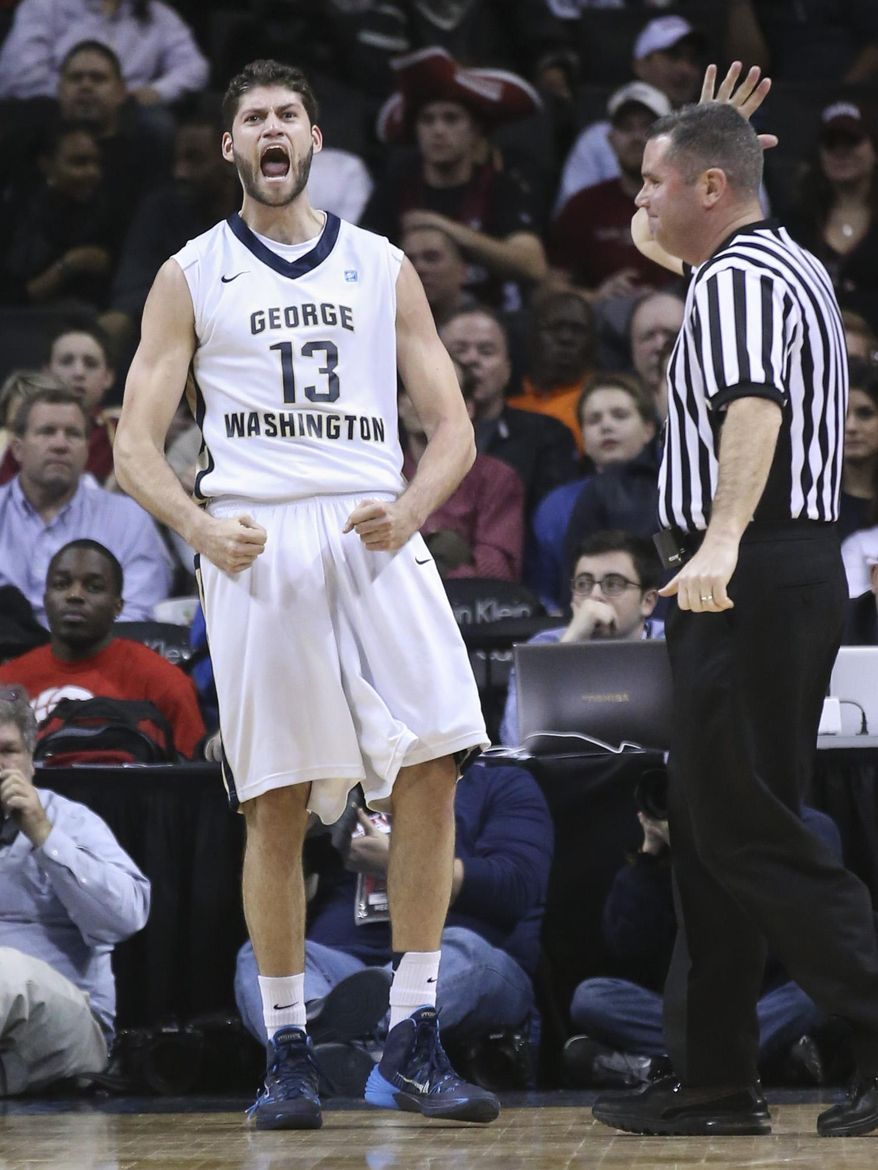 George Washington guard/forward Patricio Garino (13) reacts after scoring during the first half of an NCAA college basketball game against UMass in the quarterfinal round of the Atlantic 10 Conference tournament at the Barclays Center in New York, Friday, March 14, 2014. (AP Photo/John Minchillo)