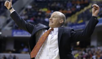 Illinois head coach John Groce reacts to a play in the first half of an NCAA college basketball game against Michigan in the quarterfinals of the Big Ten Conference tournament Friday, March 14, 2014, in Indianapolis. (AP Photo/Michael Conroy)