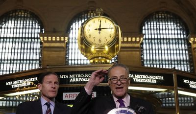 "U.S. Sen. Richard Blumenthal, D-CT, left, and U.S. Sen. Charles Schumer, D-NY, comment on a report by the Federal Railroad Administration about the Metro-North Railroad, at the information booth in New York's Grand Central Terminal,  Friday, March 14, 2014. Metro-North commuter railroad has allowed an overemphasis on train times to ""routinely"" overshadow its safety operations, according to an FRA review that was released Friday. (AP Photo/Richard Drew)"