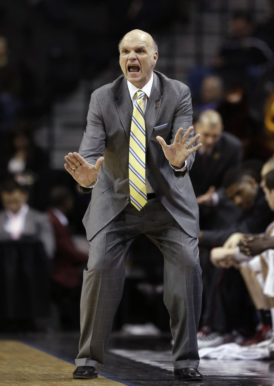 Saint Joseph's head coach Phil Martelli gestures during the first half of an NCAA college basketball game against Dayton in the quarterfinal round of the Atlantic 10 Conference tournament at the Barclays Center in New York, Friday, March 14, 2014. (AP Photo/Seth Wenig)