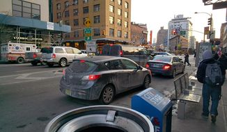 In this Jan. 31, 2014 photo taken using Google Glass, vehicles are stopped at a traffic light in New York. (AP Photo/Barbara Ortutay)