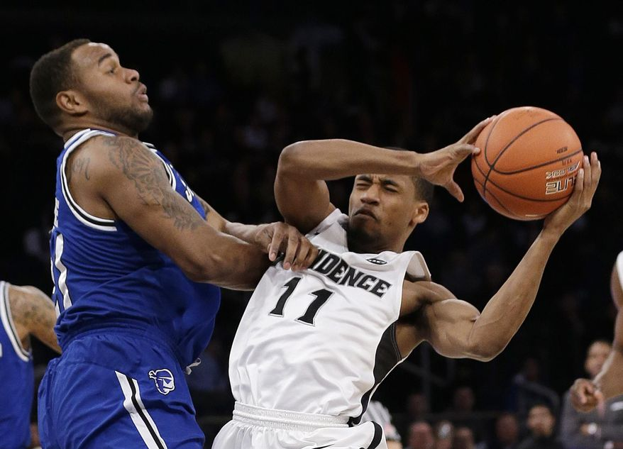 Seton Hall's Eugene Teague. left, fouls Providence's Bryce Cotton (11) during the first half of an NCAA college basketball game in the semifinals of the Big East Conference men's tournament Friday, March 14, 2014, at Madison Square Garden in New York. (AP Photo/Frank Franklin II)