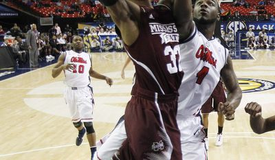 Mississippi State guard Craig Sword (32) shoots over Mississippi center Demarco Cox (4) during the first half of an NCAA college basketball game in the second round of the Southeastern Conference men's tournament, Thursday, March 13, 2014, in Atlanta. (AP Photo/Steve Helber)