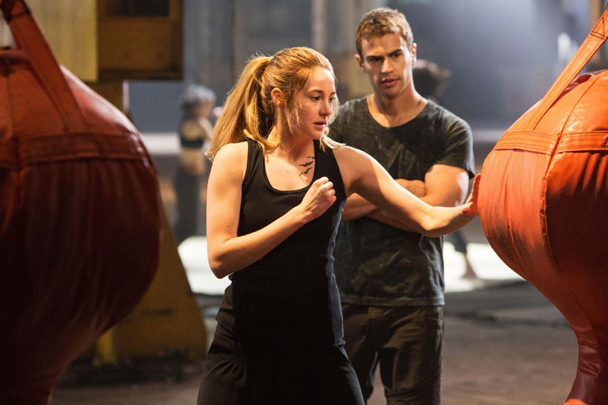 """This photo released by Summit Entertainment, LLC shows Shailene Woodley as Beatrice """"Tris"""" Prior, left, and Theo James as Four, in the film, """"Divergent."""" (AP Photo/Summit Entertainment, Jaap Buitendijk)"""