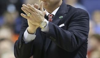North Carolina State head coach Mark Gottfried cheers on his team against Syracuse during the first half of a quarterfinal NCAA college basketball game at the Atlantic Coast Conference tournament in Greensboro, N.C., Friday, March 14, 2014. (AP Photo/Gerry Broome)