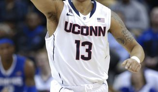 Connecticut guard Shabazz Napier celebrates a score against Memphis during the first half of an NCAA college basketball game in the quarterfinals of the American Athletic Conference men's tournament Thursday, March 13, 2014, in Memphis, Tenn. (AP Photo/Mark Humphrey)