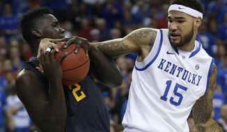 LSU forward Johnny O'Bryant III (2) holds onto the ball as Kentucky forward Willie Cauley-Stein (15) defends during the second half of an NCAA college basketball game in the quarterfinal round of the Southeastern Conference men's tournament, Friday, March 14, 2014, in Atlanta. (AP Photo/John Bazemore)