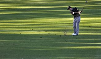 Danny Lee, of New Zealand, hits along the fifth fairway during the first round of the Valspar Championship golf tournament at Innisbrook Thursday, March 13, 2014, in Palm Harbor, Fla. (AP Photo/Chris O'Meara)