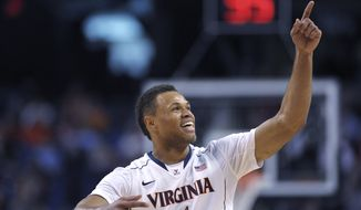 Virginia guard Justin Anderson points to the crowd in celebration during Virginia's 64-51 over Florida State in an NCAA college basketball game in the quarterfinals of the Atlantic Coast Conference men's tournament, Friday, March 14, 2014, in Greensboro, N.C. (AP Photo/Burlington Times-News, Scott Muthersbaugh)