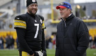 Pittsburgh Steelers quarterback Ben Roethlisberger, left, talks with former Buffalo Bills quarterback Jim Kelly before an NFL football game between the Pittsburgh Steelers and the Buffalo Bills, Sunday, Nov. 10, 2013, in Pittsburgh. (AP Photo/Gene J. Puskar)