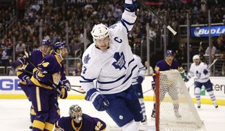 Toronto Maple Leafs' Dion Phaneuf, center, celebrates his goal against the Los Angeles Kings during the first period of an NHL hockey game on Thursday, March 13, 2014, in Los Angeles. (AP Photo/Jae C. Hong)