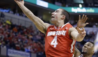 Ohio State guard Aaron Craft (4) goes up for a shot against Nebraska during the first half of an NCAA college basketball game in the quarterfinals of the Big Ten Conference tournament Friday, March 14, 2014, in Indianapolis. (AP Photo/Michael Conroy)