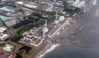 **FILE** The Fukushima Dai-Ichi nuclear plant at Okuma in Fukushima prefecture, northern Japan, is seen here on Aug. 20, 2013. Scientists have crowd-sourced a volunteer network to monitor radiation moving across the Pacific Ocean since the 2011 earthquake and tsunami damaged the plant. (AP Photo/Kyodo News)