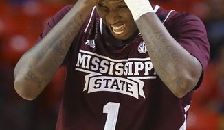 Mississippi State guard Fred Thomas reacts after being knocked to the hardwood during the second half against Mississippi during an NCAA college basketball game in the Southeastern Conference men's tournament, Thursday, March 13, 2014, in Atlanta. (AP Photo/Atlanta Journal Constitution, Curtis Compton) GWINNETT OUT  MARIETTA OUT  LOCAL TV OUT (WXIA, WGCL, FOX 5)