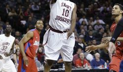 Saint Joseph's Langston Galloway puts up a shot during the first half of an NCAA college basketball game against Dayton in the quarterfinal round of the Atlantic 10 Conference tournament at the Barclays Center in New York, Friday, March 14, 2014. (AP Photo/Seth Wenig)