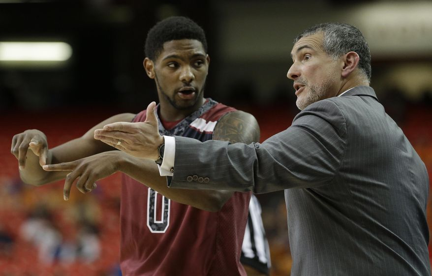 South Carolina head coach Frank Martin speaks to Sindarius Thornwell during the second half of an NCAA college basketball game against Tennessee in the quarterfinal round of the Southeastern Conference men's tournament, Friday, March 14, 2014, in Atlanta. (AP Photo/Steve Helber)