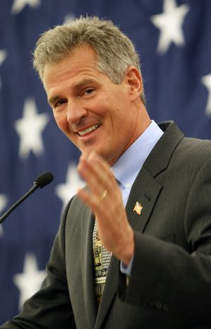 Former Massachusetts Senator Scott Brown acknowledges his wife Gail as he announces his plans to form an exploratory committee to enter New Hampshire's U.S. Senate race against Democratic Sen. Jeanne Shaheen,, Friday, March 14, 2014 in Nashua, N.H. (AP Photo/Jim Cole)