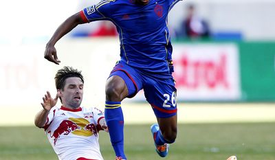 Colorado Rapids forward Deshorn Brown, top, gets past the slide tackle attempt of New York Red Bulls midfielder Bobby Convey during the first half of an MLS soccer game, Saturday, March 15, 2014, in Harrison, N.J. (AP Photo/Julio Cortez)