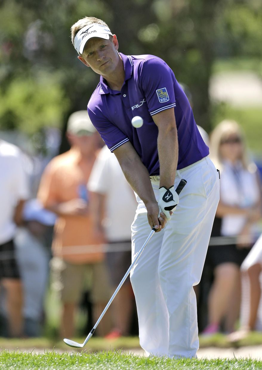Luke Donald, of England, chips onto the 17th green during the third round of the Valspar Championship golf tournament at Innisbrook Saturday, March 15, 2014, in Palm Harbor, Fla. (AP Photo/Chris O'Meara)