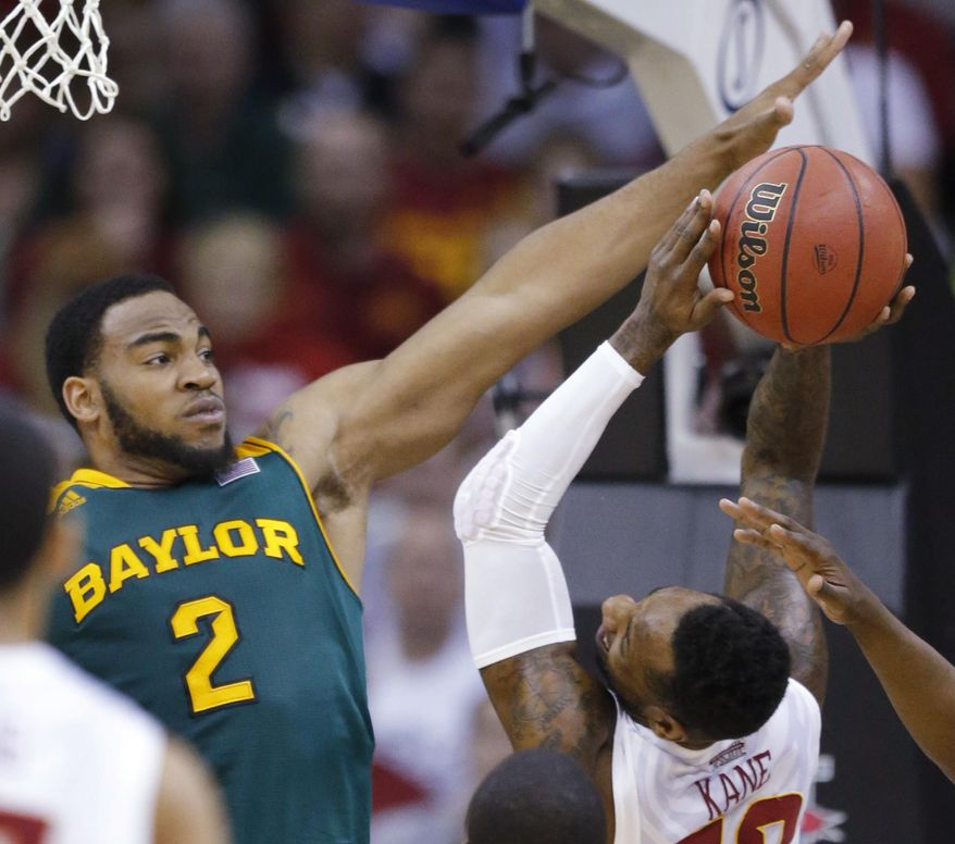 Iowa State guard DeAndre Kane, right, is fouled by Baylor forward Rico Gathers (2) during the first half of an NCAA college basketball game in the final of the Big 12 Conference men's tournament in Kansas City, Mo., Saturday, March 15, 2014. (AP Photo/Orlin Wagner)