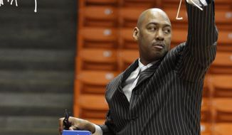 Tulsa coach Danny Manning holds up the net after cutting the final strand folling their 69-60 win over  Louisiana Tech an NCAA college basketball game in the championship of the Conference USA tournament Saturday, March 15, 2014 in El Paso, Texas. (AP Photo/Victor Calzada)