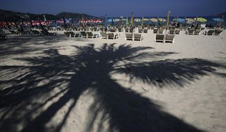 Tourists spend time on Patong Beach in Phuket province, southern Thailand in this March 13, 2014, photo. (AP Photo/Sakchai Lalit)
