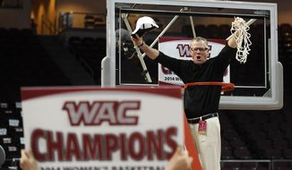 Idaho coach John Newlee celebrates after his team defeated Seattle in an NCAA college basketball game in the championship of the Western Athletic Conference tournament Saturday, March 15, 2014, in Las Vegas. Idaho won 75-67. (AP Photo/David Becker)