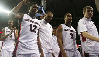 Georgia guard Kenny Gaines (12) and players walk of the court after beating Mississippi 75-73 after the second half of an NCAA college basketball game in the quarterfinal round of the Southeastern Conference men's tournament, Saturday, March 15, 2014, in Atlanta. (AP Photo/John Bazemore)
