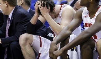 Wisconsin forward Frank Kaminsky, left, looks down on the bench in the second half of an NCAA college basketball game against Michigan State in the semifinals of the Big Ten Conference tournament Saturday, March 15, 2014, in Indianapolis. Michigan State won 83-75. (AP Photo/Michael Conroy)