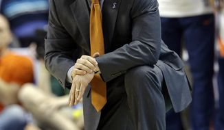 Virginia head coach Tony Bennett directs his team against Pittsburgh during the second half of an NCAA college basketball game in the semifinals at the Atlantic Coast Conference tournament in Greensboro, N.C., Saturday, March 15, 2014. (AP Photo/Gerry Broome)