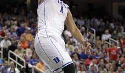 Duke's Jabari Parker (1) dunks against North Carolina State during the second half of an NCAA college basketball game in the semifinals of the Atlantic Coast Conference tournament in Greensboro, N.C., Saturday, March 15, 2014. (AP Photo/Bob Leverone)
