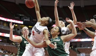 Cal State Northridge's Ashlee Guay (5) and Cal Poly's Kristen Ale (11) fight for a rebound during the first half of an NCAA college basketball game in the final of the Big West Conference tournament, on Saturday, March 15, 2014, in Anaheim, Calif. (AP Photo/Jae C. Hong)