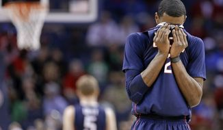 Connecticut forward DeAndre Daniels (2) wipes his face during the second half of an NCAA college basketball game against Louisville in the final of the American Athletic Conference men's tournament Saturday, March 15, 2014, in Memphis, Tenn. Louisville won 71-61. (AP Photo/Mark Humphrey)