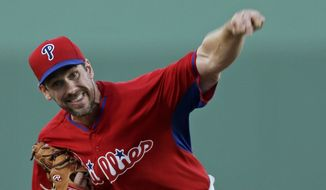 Philadelphia Phillies starting pitcher Cliff Lee pitches in the first inning of an exhibition baseball game against the Boston Red Sox in Fort Myers, Fla., Saturday, March 15, 2014. (AP Photo/Gerald Herbert)