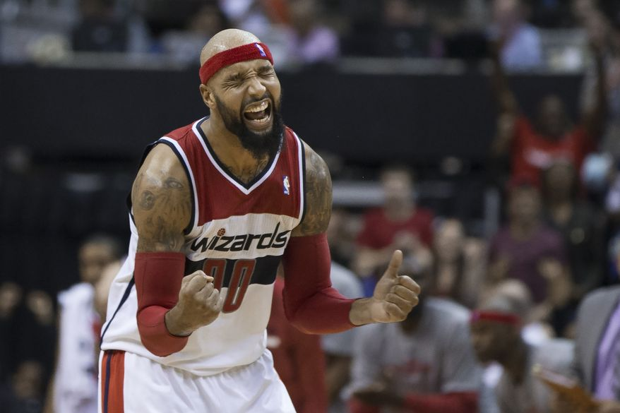 Washington Wizards forward Drew Gooden celebrates a basket during the second half of an NBA basketball game against the Brooklyn Nets on Saturday, March 15, 2014, in Washington. The Wizards defeated the Nets 101-94. (AP Photo/ Evan Vucci)
