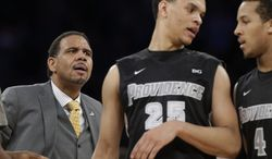 Providence head coach Ed Cooley glares at Providence's Tyler Harris (25) and Josh Fortune (4) after Fortune fouled Creighton's Avery Dingman during the first half of an NCAA college basketball game against Creighton in the finals of the Big East Conference tournament Saturday, March 15, 2014, at Madison Square Garden in New York. (AP Photo/Frank Franklin II)
